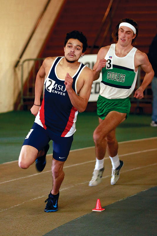 Metro sophomore Ivan Rangel races forward with the Denver Track Club's Chris Christoff close behind during th Potts Invitational held at CU Boulder Jan. 16. The track team's head coach believes younger athletes like Rangel gained valuable experience from the meet. Photo by Keenan McCall • kmccall3@msudenver.edu